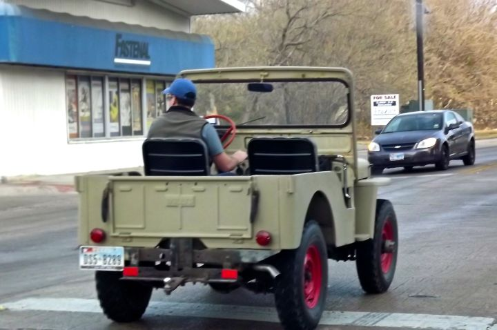 Tried chasing this guy down this morning (thus the poor focused photo) - it's a Willys Jeep which the military quit making in 1945. This one is still in pretty good shape for being at least 67 years old....