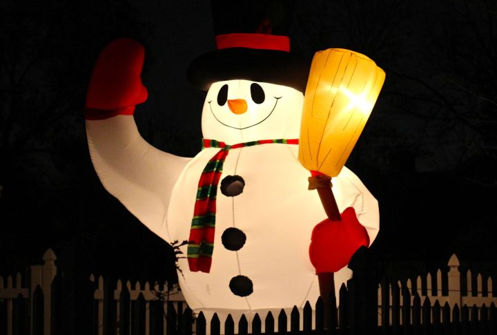 Frosty waving his hand in the neighbor's yard....