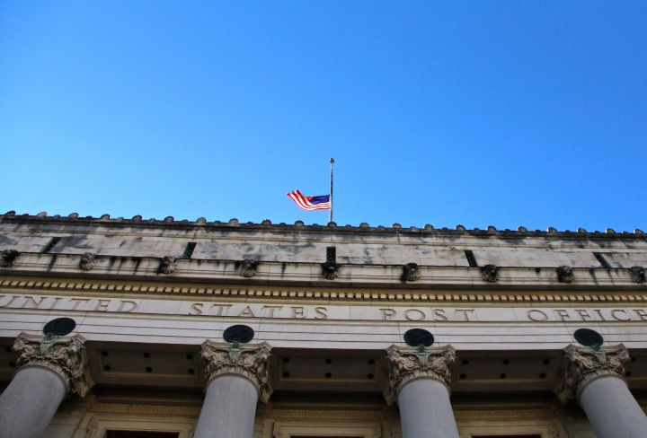 The iconic 79-year old Fort Worth Post Office is located on the south edge of downtown. The flag is a half-staff because of the Newtown school shooting tragedy.