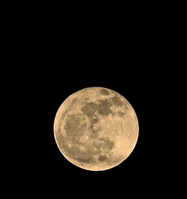 With the help of simple post-processing, one can get a warm glow to the full moon....