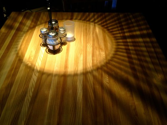 While at lunch today I saw this light effect from a way-cool fixture over a table - I think the folks thought I was nuts when I asked them if they could hold their plates off the table...just for a second. HaHaHa. this photo blogging bit has got a hold of me :)
