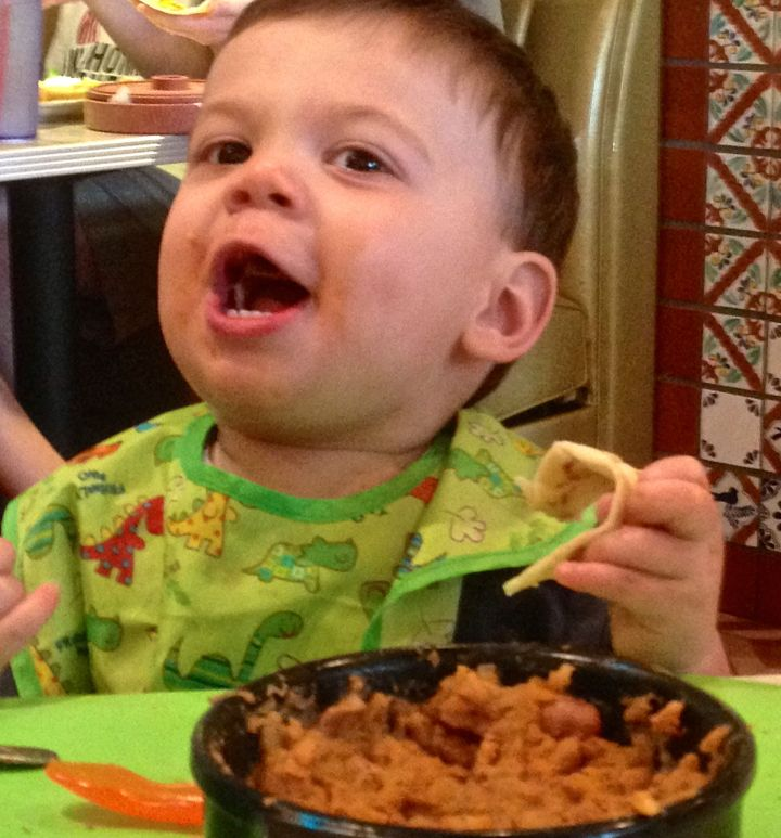 A tortilla and a bowl of beans and rice would bring a smile to anyone's face, right? Living life fully (at this age there are only two other things you gotta do) and experiencing the world through his perspective