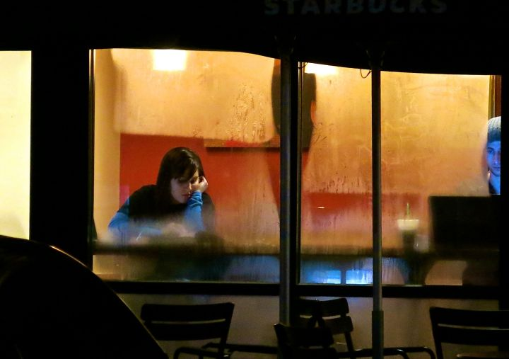 A young lady (and is the guy on the right creepy kind of creepy to any one else?) Starbucking at a partially fogged over window (thanks to winter finally making its way to Texas)….