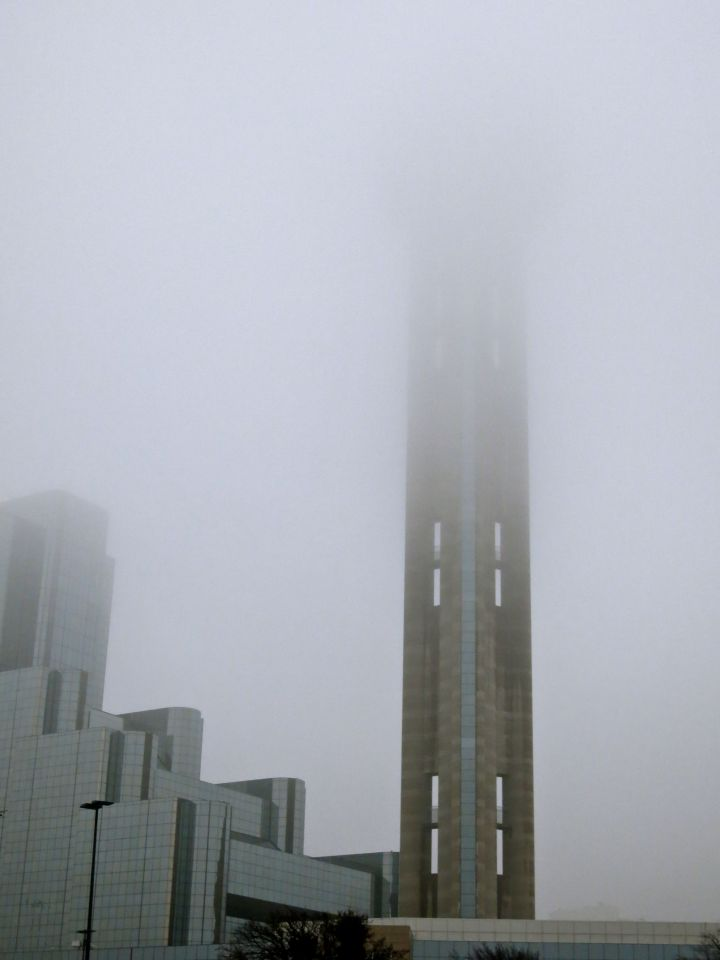 "The signature Hyatt Reunion Tower (""ball on a stick"") is missing it's top half in today's fog..."