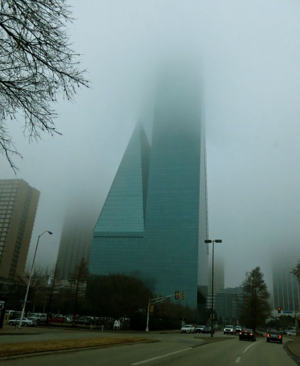 "Downtown Dallas' space ship building (what used to be called Allied Bank Tower back when I ""did"" the public plaza area) seems to be blasting off into the fog…."