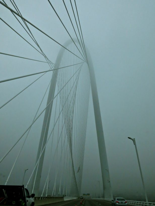The new Margaret Hunt  Hill bridge (Santiago Calatrava design) over the Trinity River west of downtown Dallas is muted by today's fog...