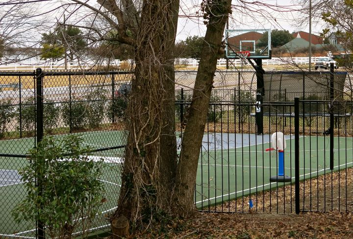 So it is that in Texas, parents with basketball aspirations for their kids will build a full court sports court in their side yard, next to the street for all to see and envy. All ages and levels of play can hit this court...