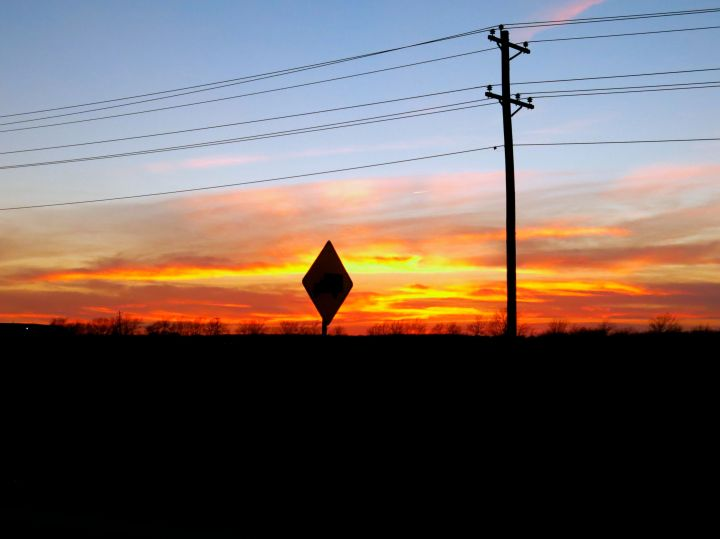 A lovely sunset…would have been better without the road sigh and power lines…maybe. It appears the power line is the divider between the blues and the oranges however...