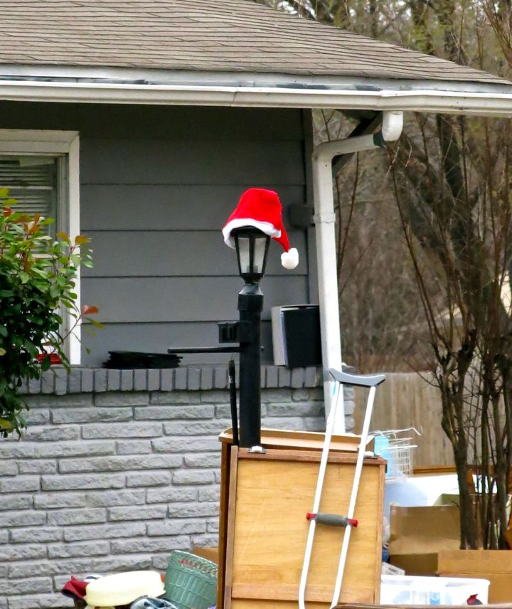 Now I'm worried - at a neighborhood yard sale is Santa Claus' cap and one crutch…somebody tell me it ain't so….