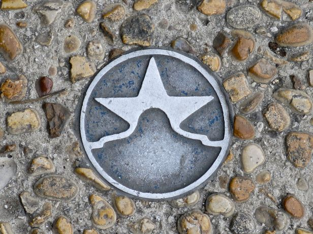 A San Antonio image medallion embedded in the sidewalk…near the Riverwalk