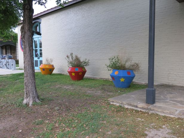 Artful pots without a sense of coordinating colors….