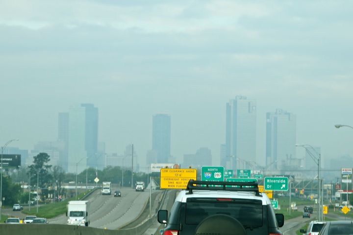 The architecture and skyline of downtown Fort Worth blend well with the overcast of the morning….