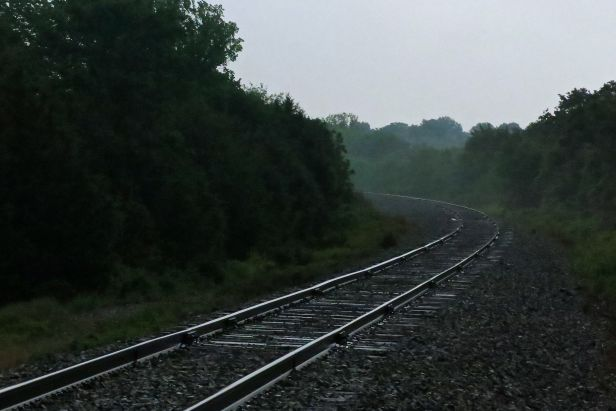 What is it about a lone pair of railroad tracks on an overcast morning that makes photographers photograph?