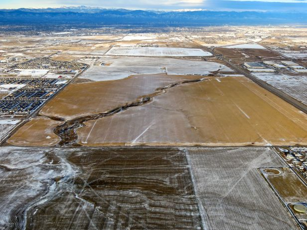 A river runs through it (cultivated field)…outside of Denver